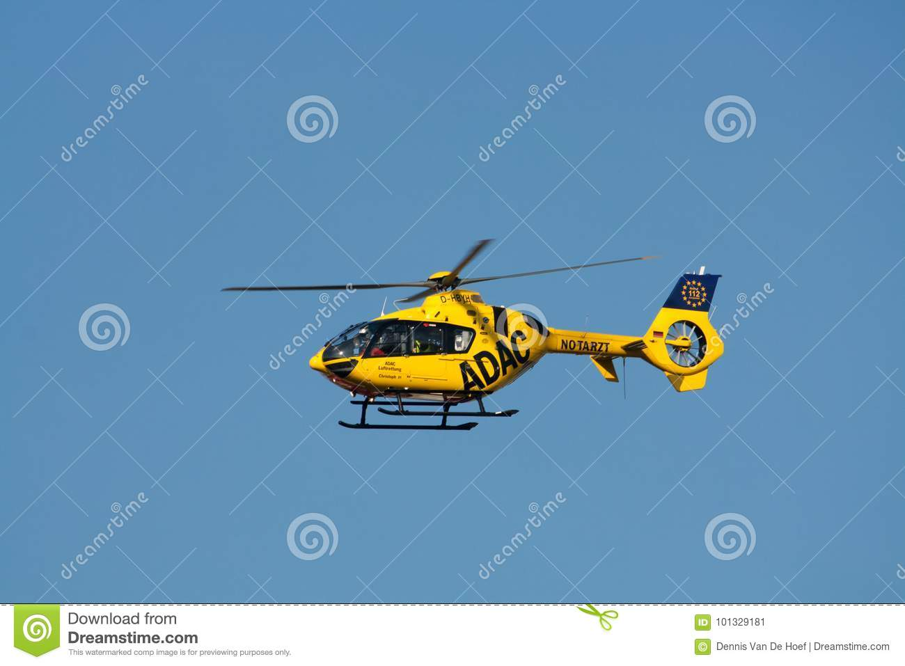Berlin - 30.09.2017: Rescue helicopter of ADAC, Christoph 31 sea. Yellow, transport.