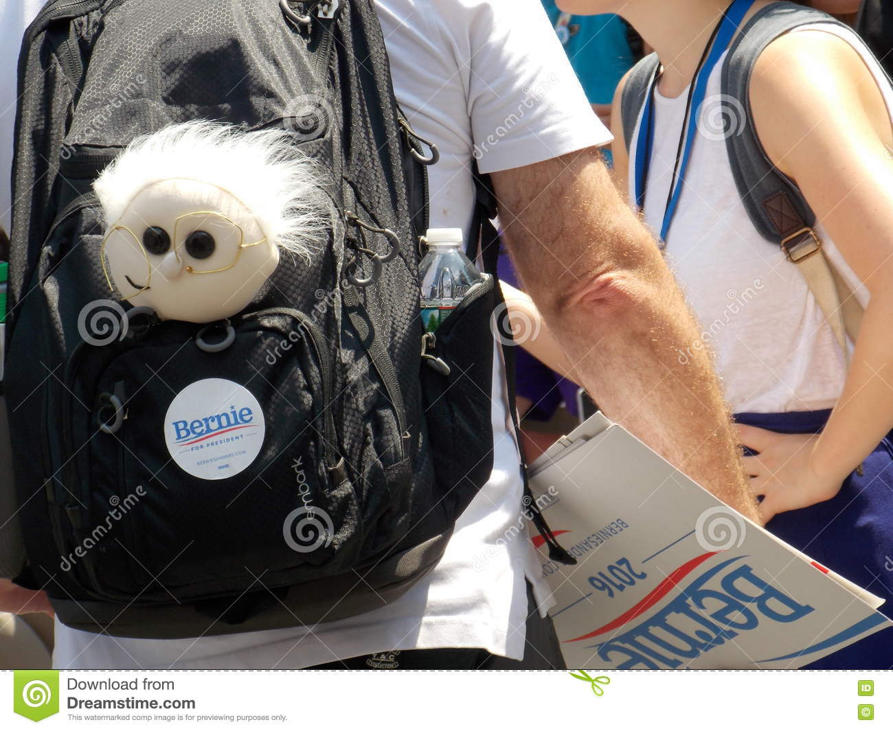 Bernie Sanders Supporter with Bernie Doll and Sign