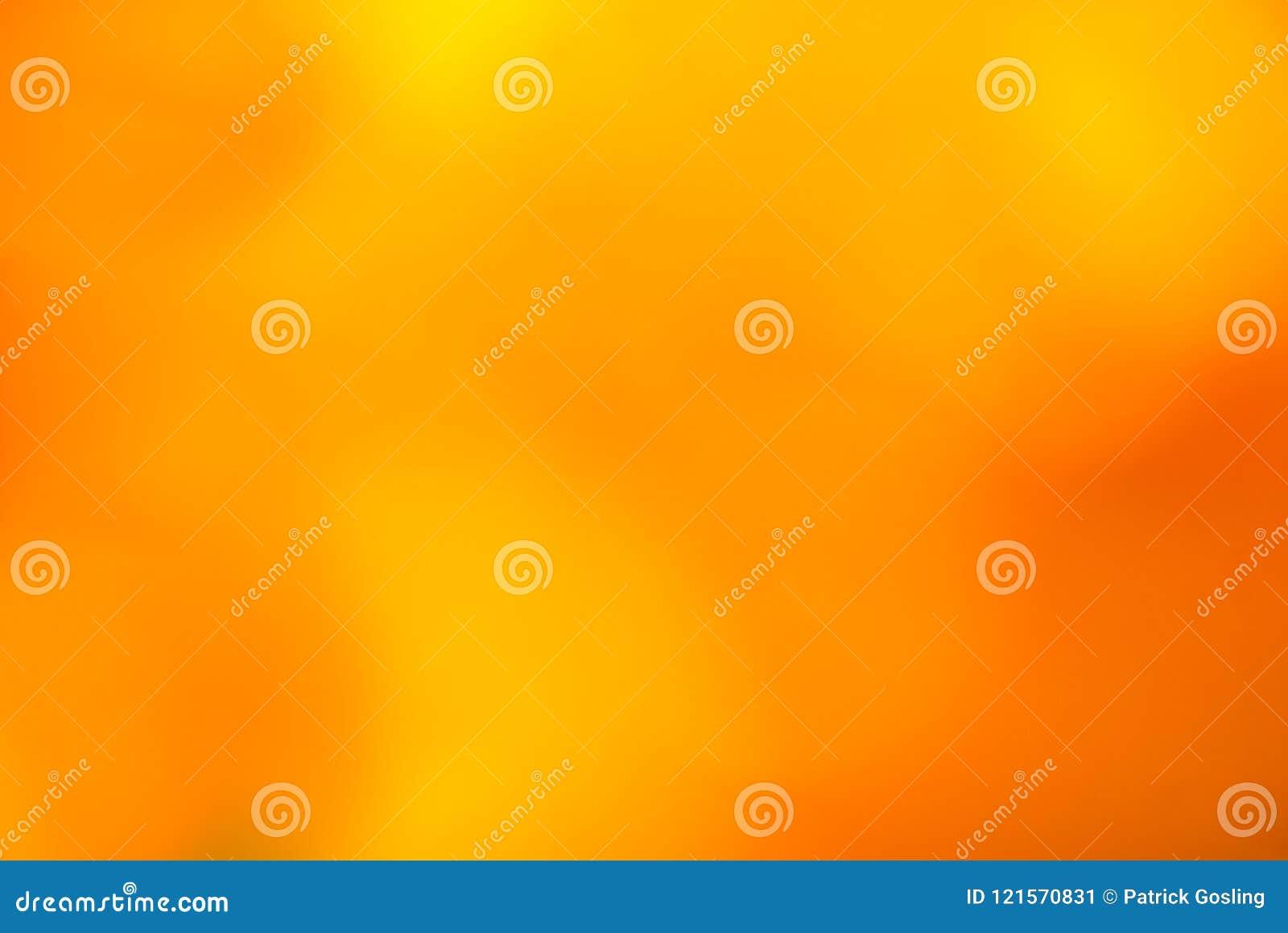 Bernsteinfarbiges und orange gebrannt Weiche unscharfer Hintergrund