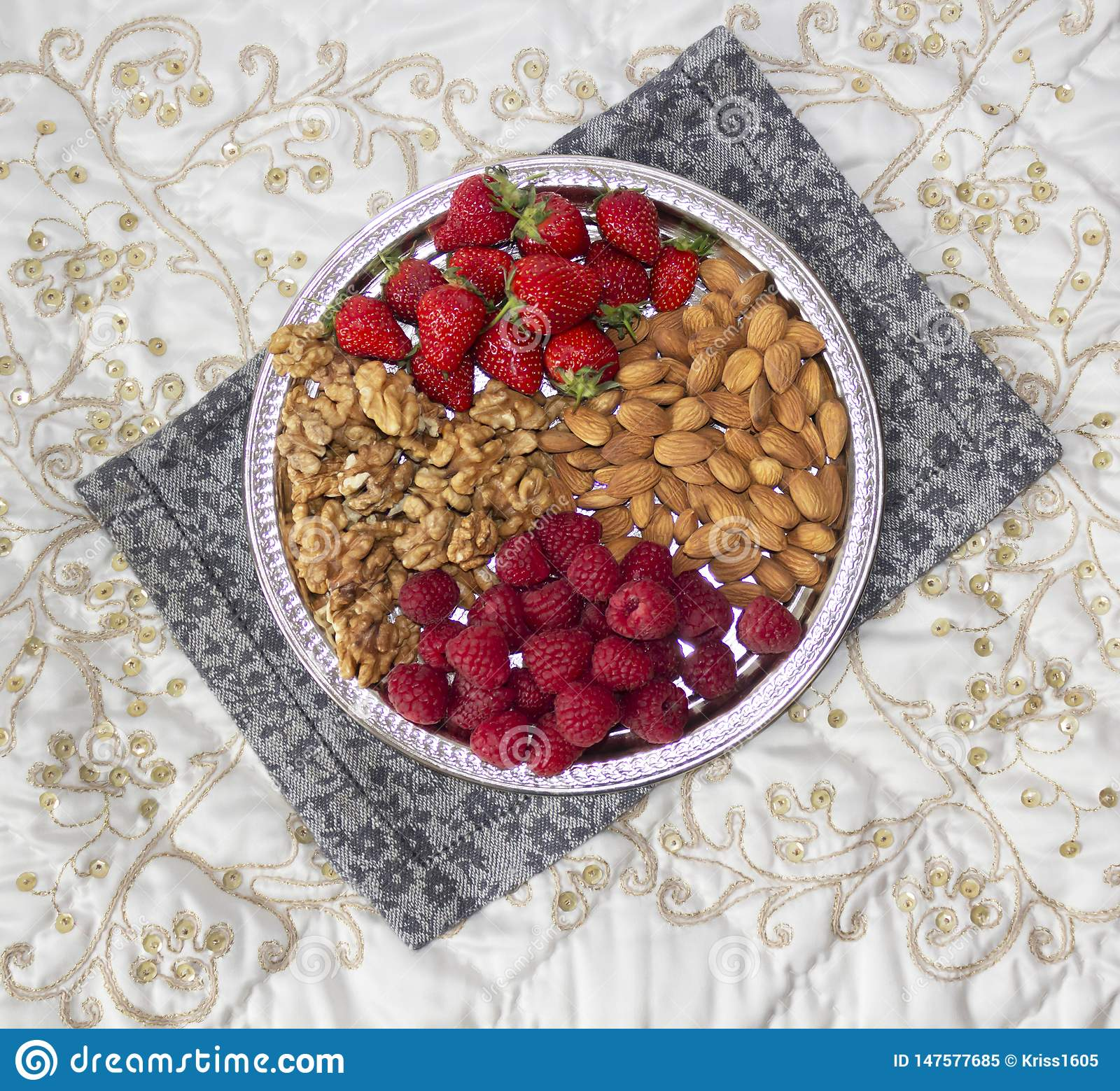 Berries and nuts on a silver tray