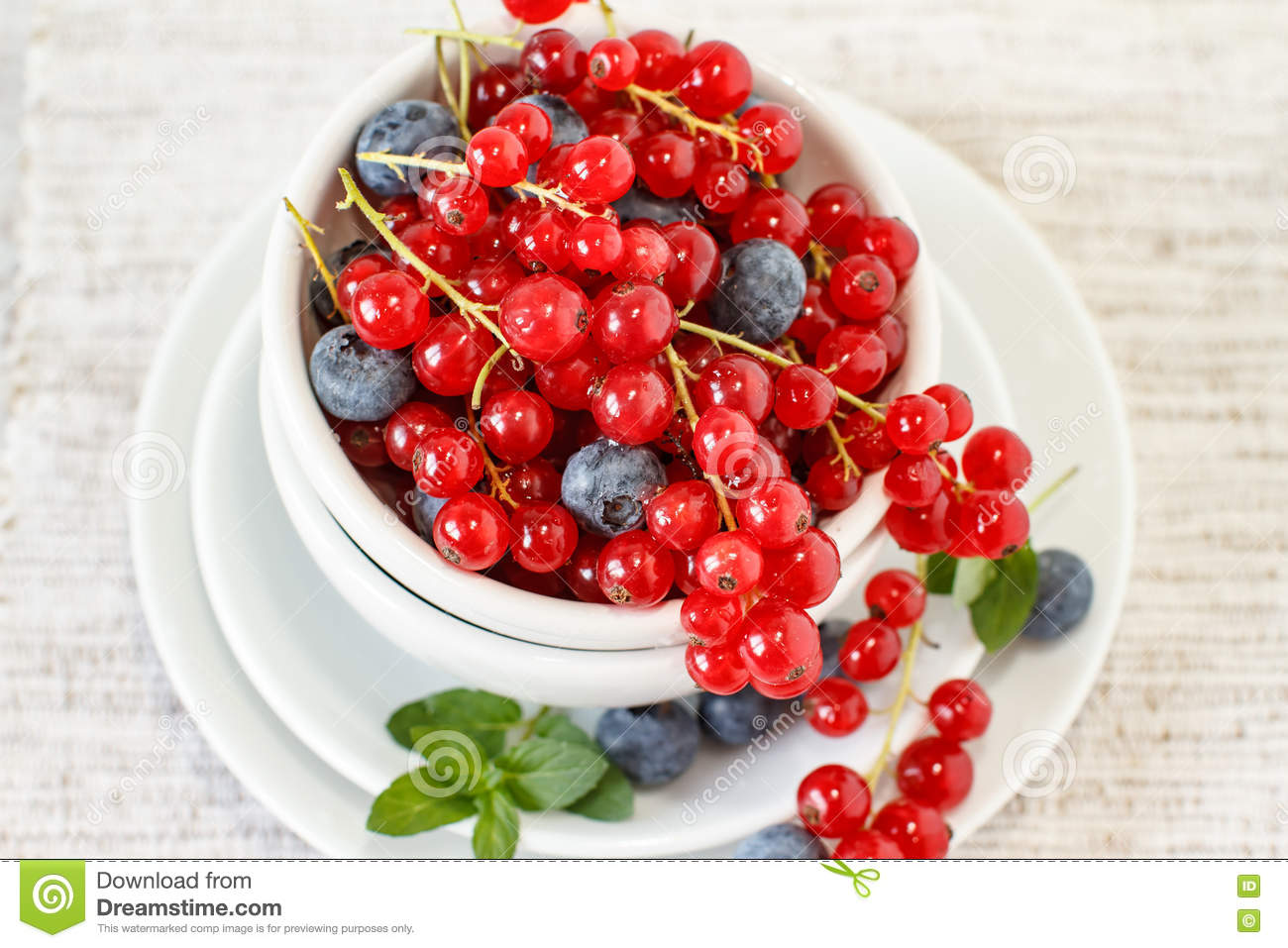 Berry fruits on white bowl