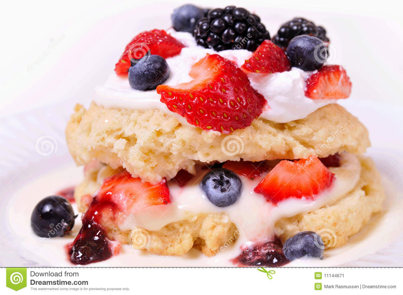 Mixed berry shortcake with whipped cream.
