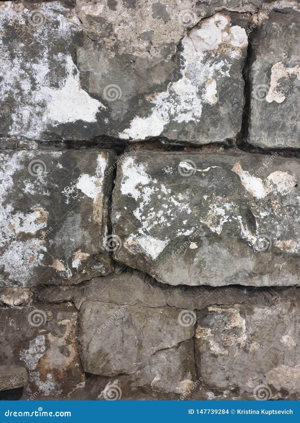 Beschaffenheit von großen alten grauen Ziegelsteinen