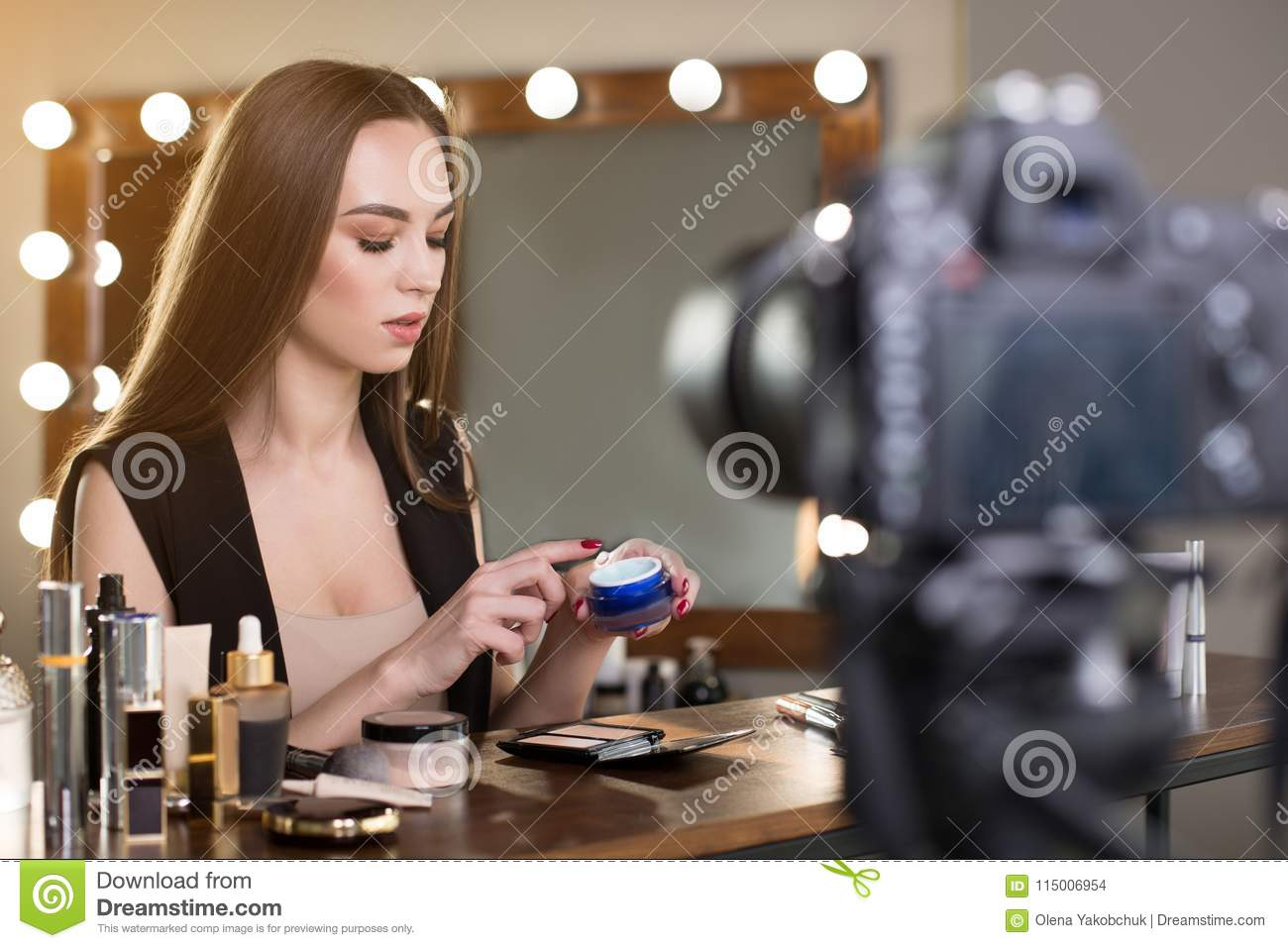 young beauty blogger with makeup tutorial stock photo - image of