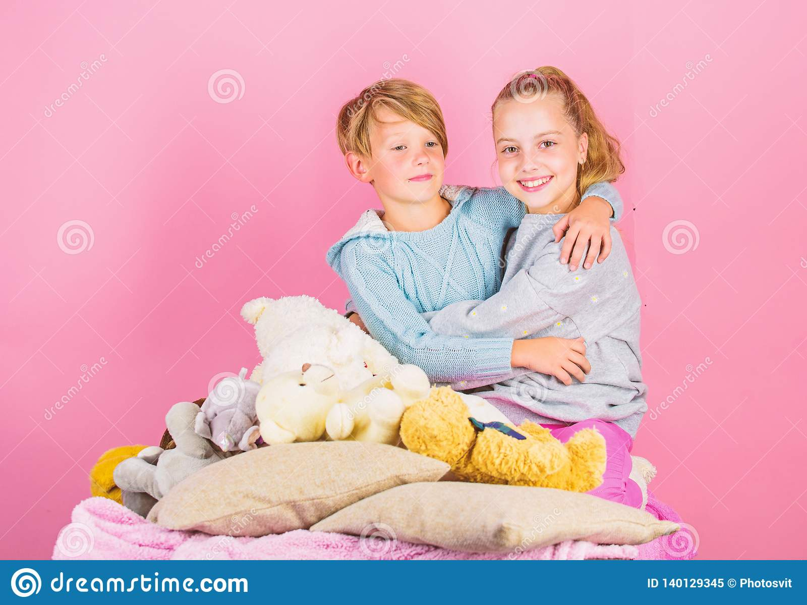 Best friends brother and sister kids siblings friends hug pink background children friends near