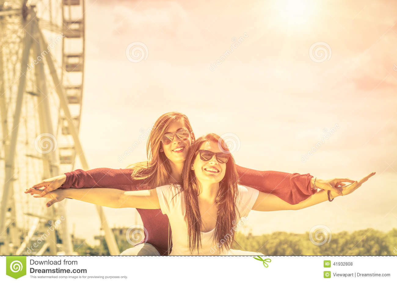 Download Best Friends Enjoying Time Together Outdoors At Ferris Wheel Stock Photo - Image of friends, attractive: 41932808