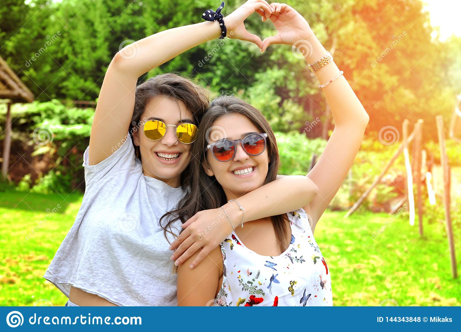 Best Friends Girls Showing Heart Gesture Stock Photo Image Of Caucasian Friends 144343848