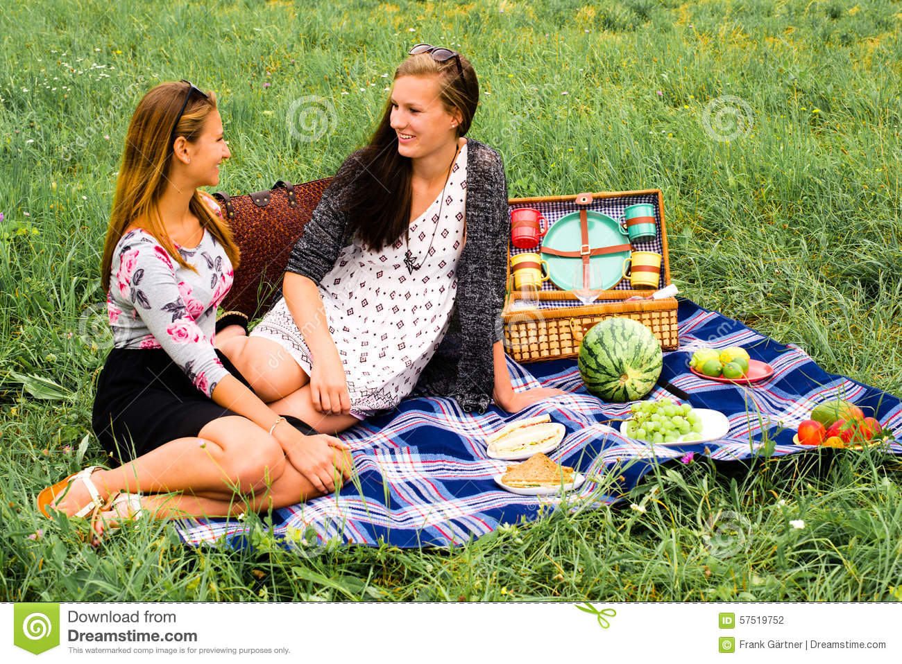 Girls Having Tea Party Picnic In Rural Field Stock Photo | Getty ...
