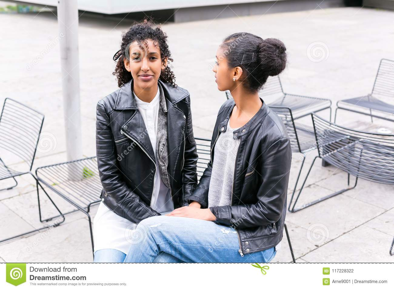 Download Best Friends Talking And Having Fun In Park Stock Photo - Image of together, girlfriends: 117228322