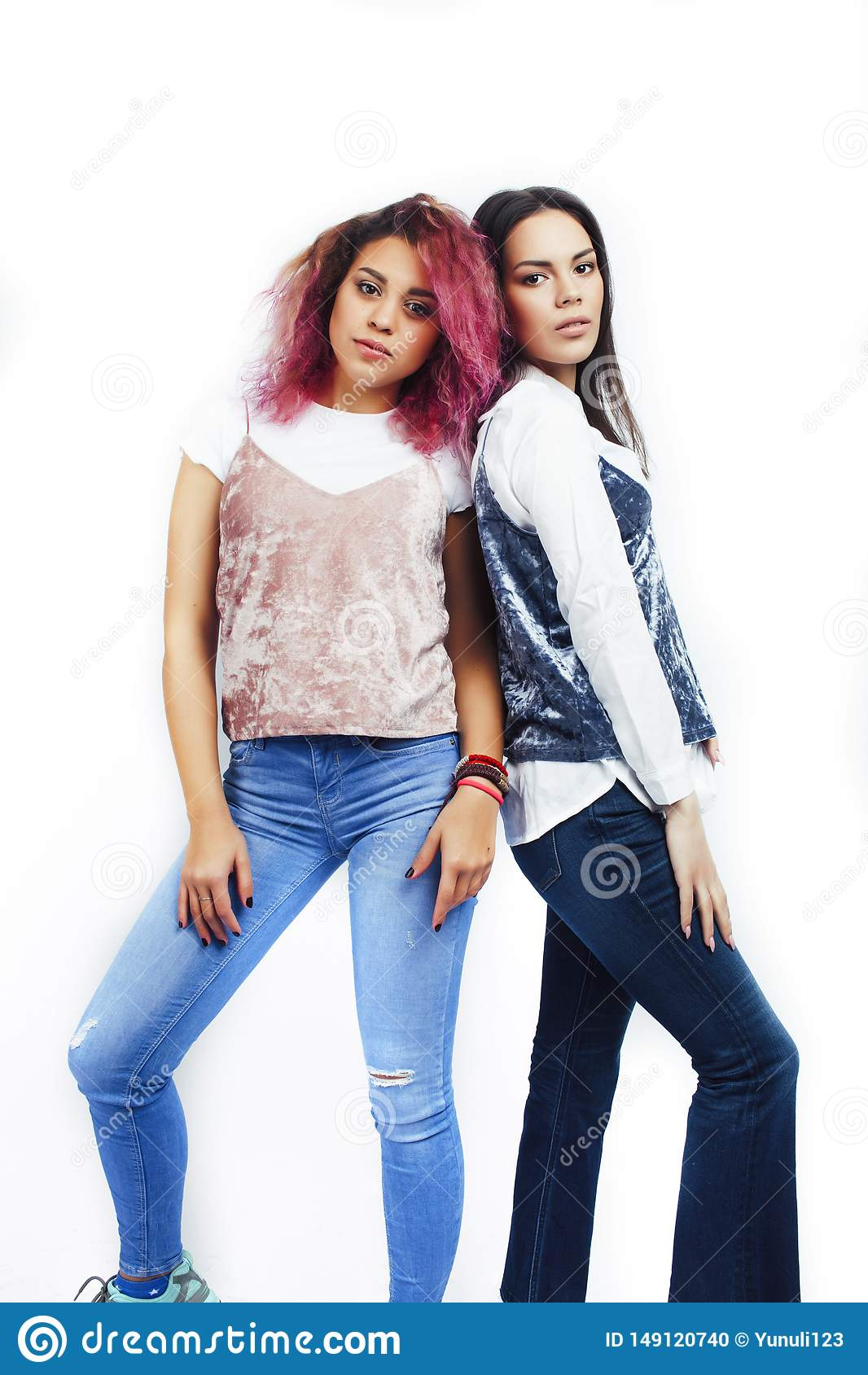 Best friends teenage girls together having fun, posing emotional isolated on white background, asian and latin american