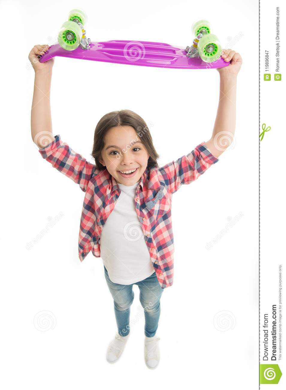Best gift ever. Kid girl happy raising penny board. Child likes plastic  skateboard as gift. Modern teen hobby. How to ride penny board.