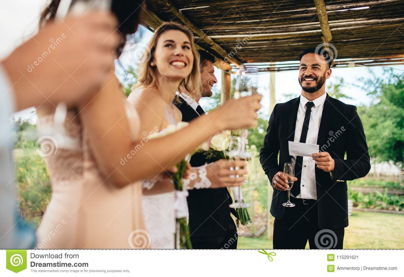 Best Man Performing Speech For Toast At Wedding Reception Stock