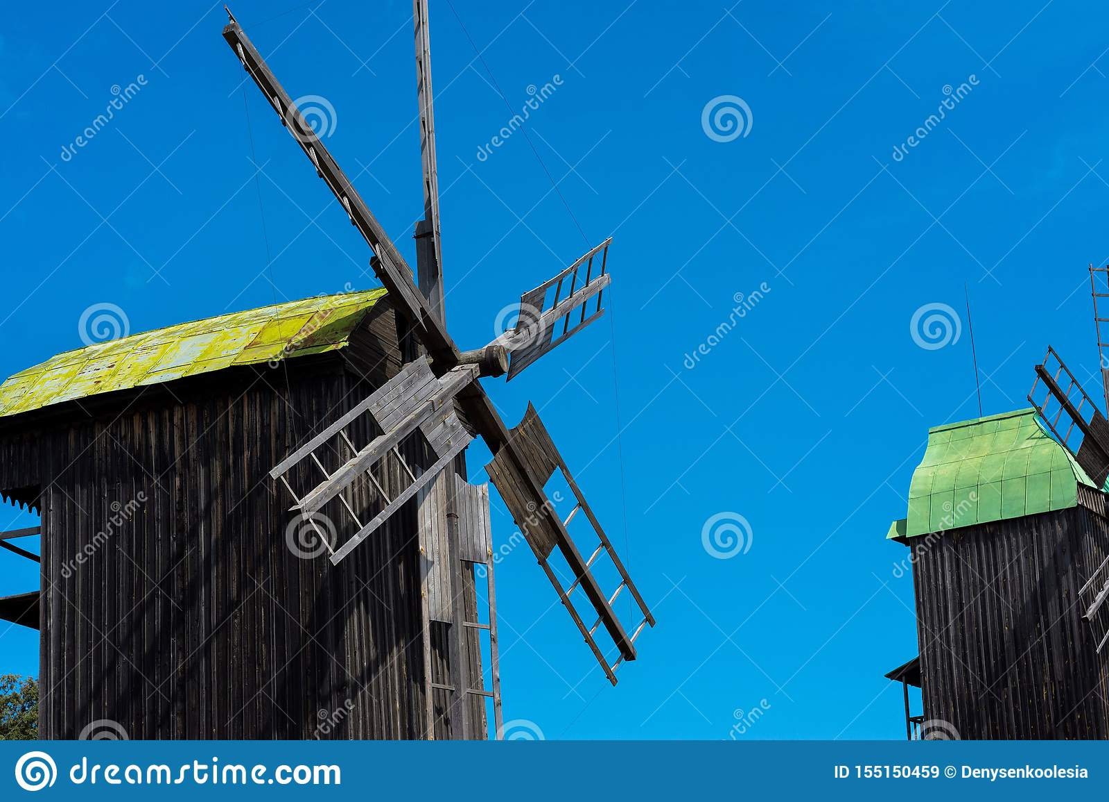 Best photo of windmill on blue sky background. Ukrainian windmill