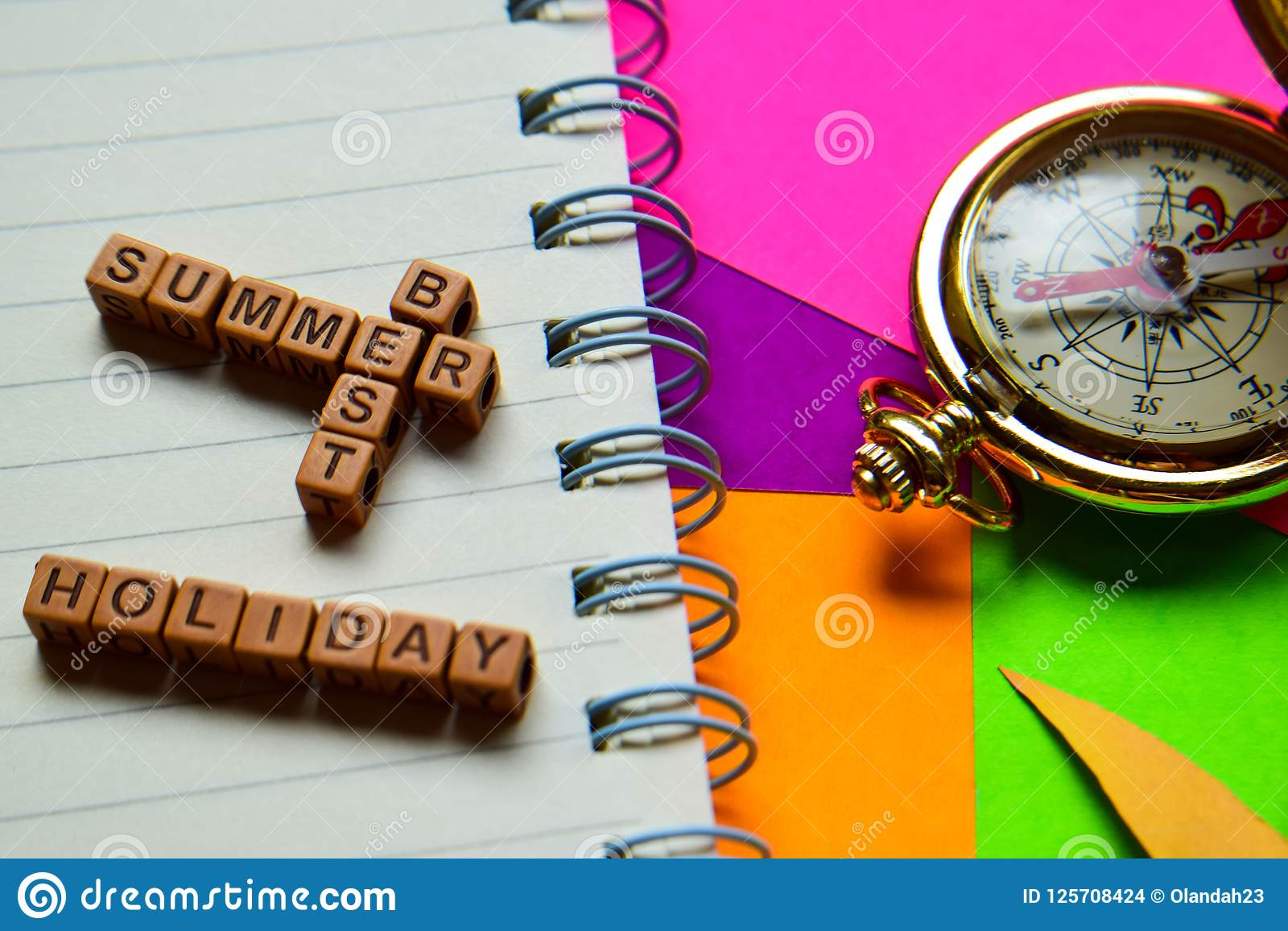 Best summer holiday message written on wooden blocks. Vacation and travel concepts. Cross processed image