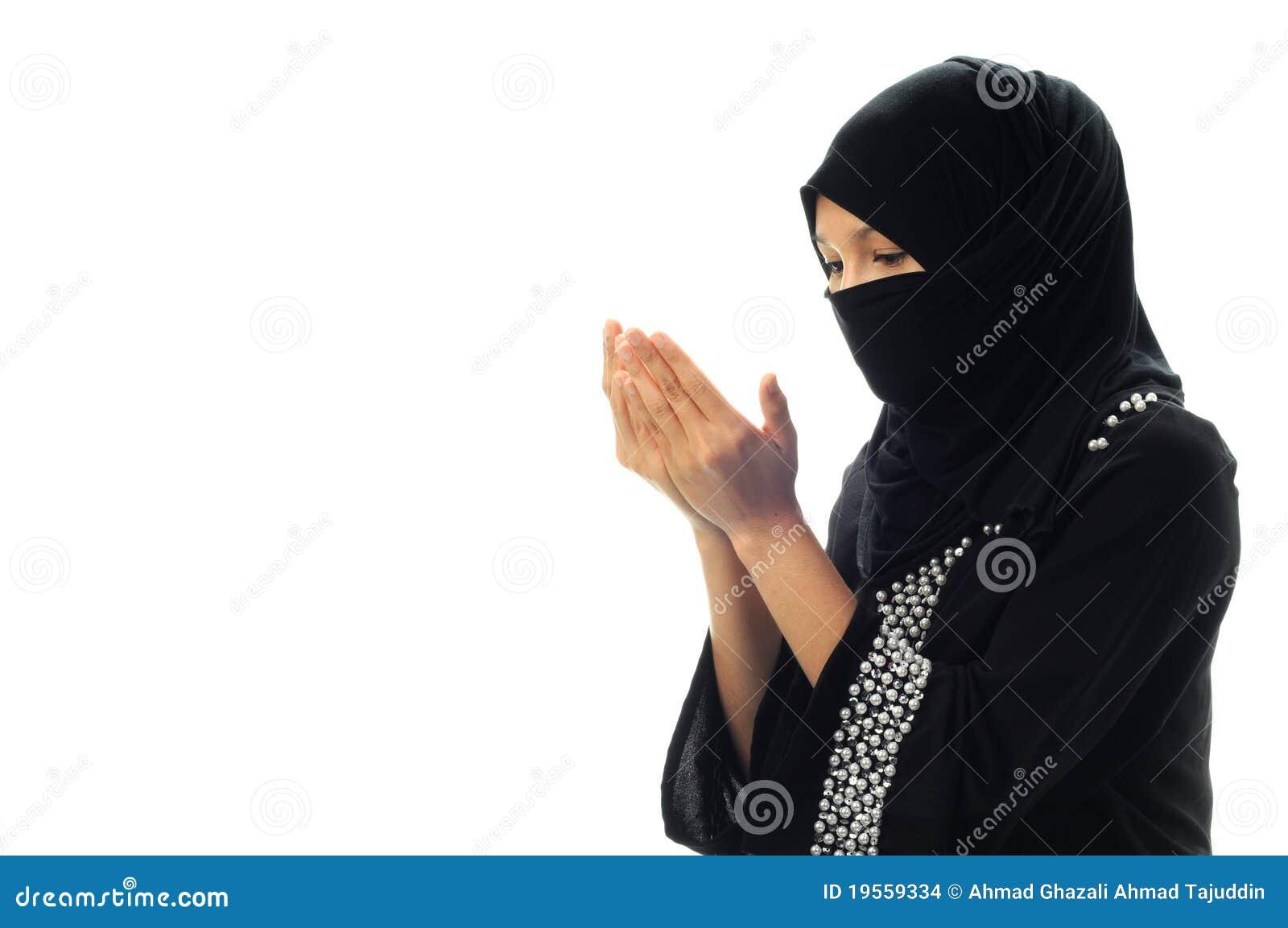 Beten moslemische Frauen das Schauen unten von seitlichem breitem