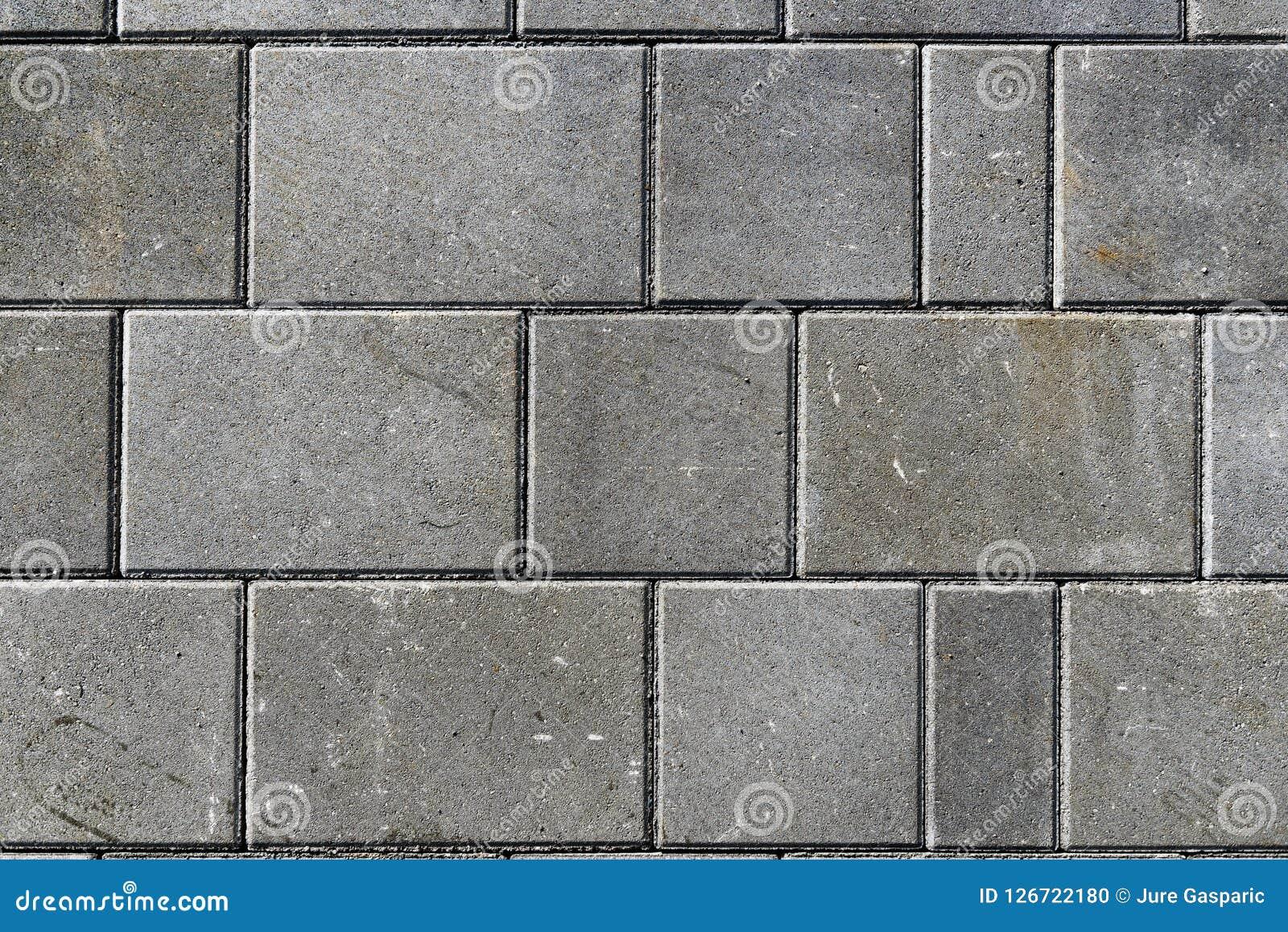 Betonuje bruków kamienie dla podłoga lub brukuje szare cegiełki lub, wal