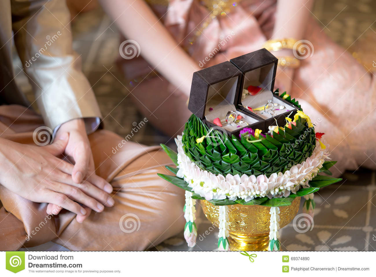 Betrothal and wedding rings / Traditional Thai wedding. - (Selective focus)