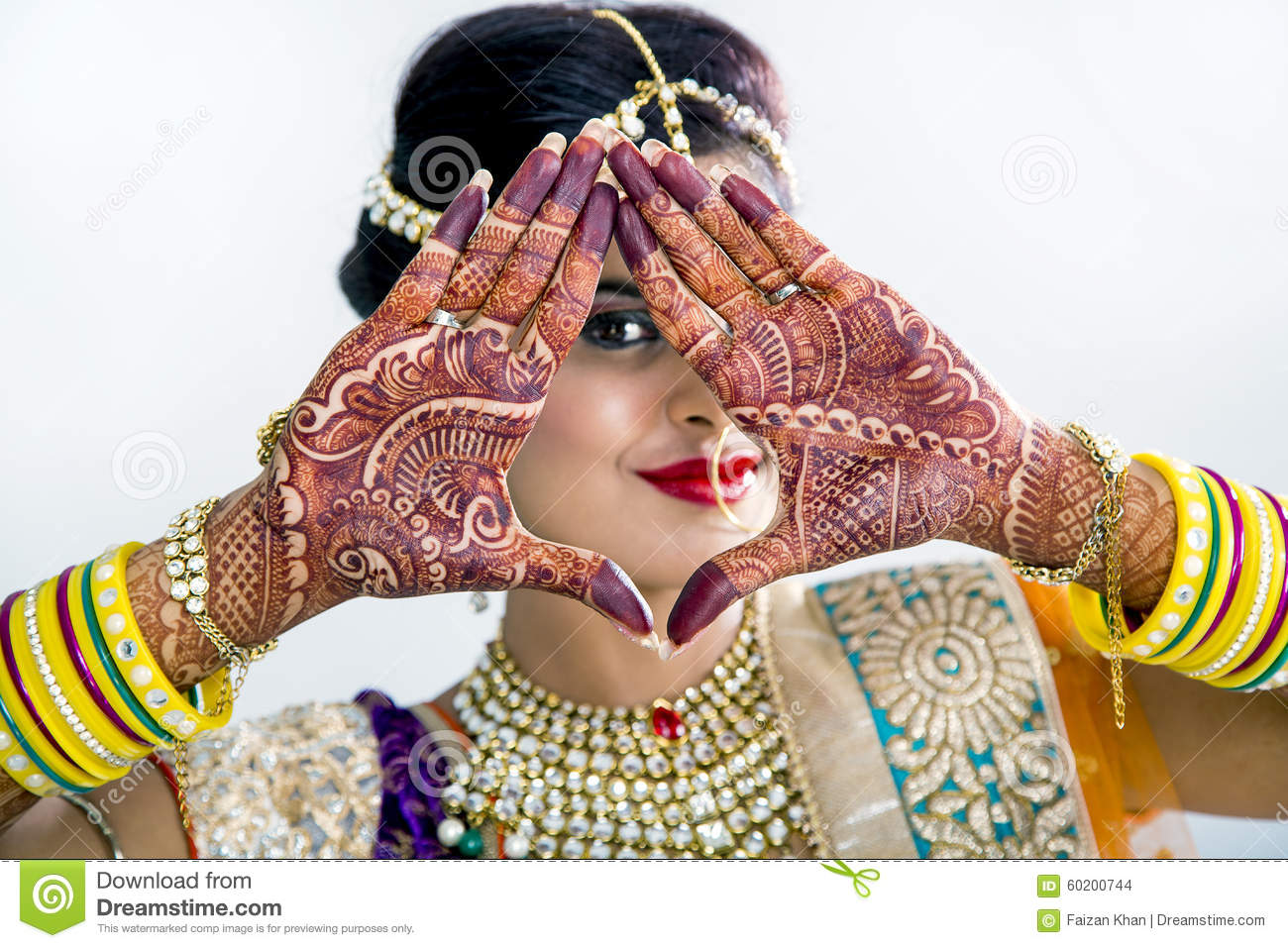 Beuatiful Indian Bride with Mehendi hands or Henna