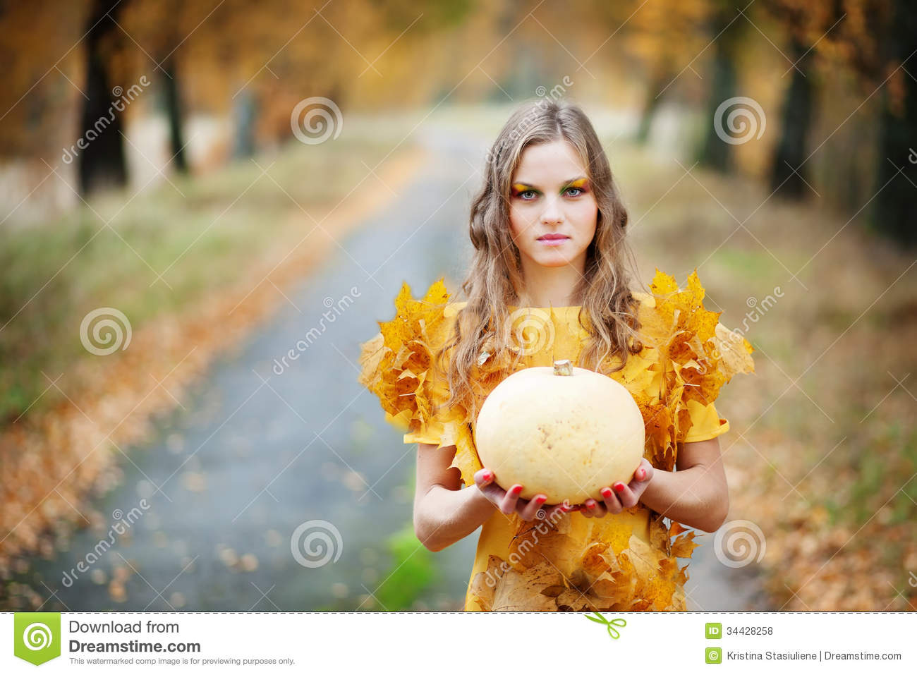 Beutiful beutiful girl holding pumpkin royalty free stock photos - image