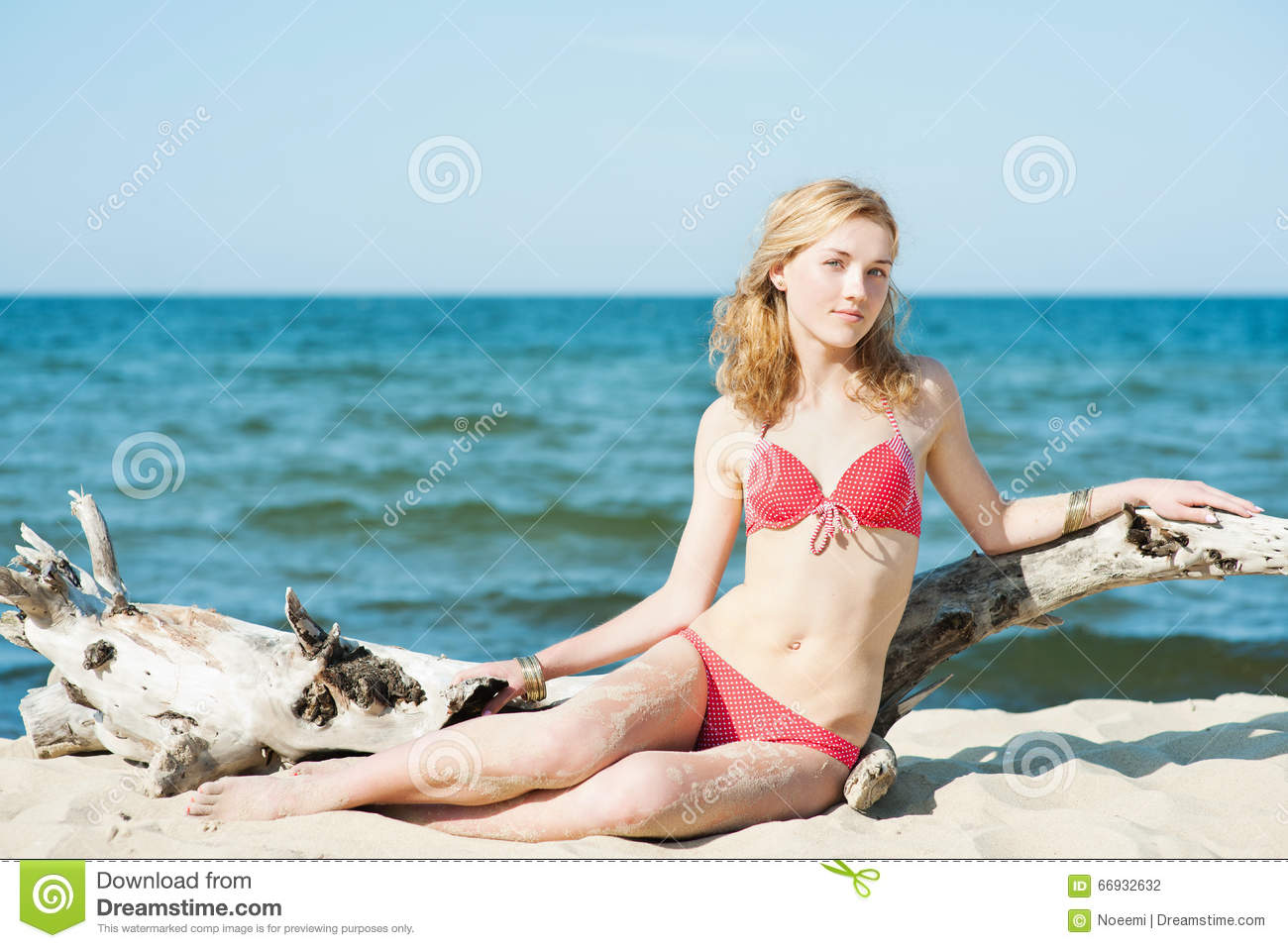 Beutiful young blond woman sunbatching on a beach