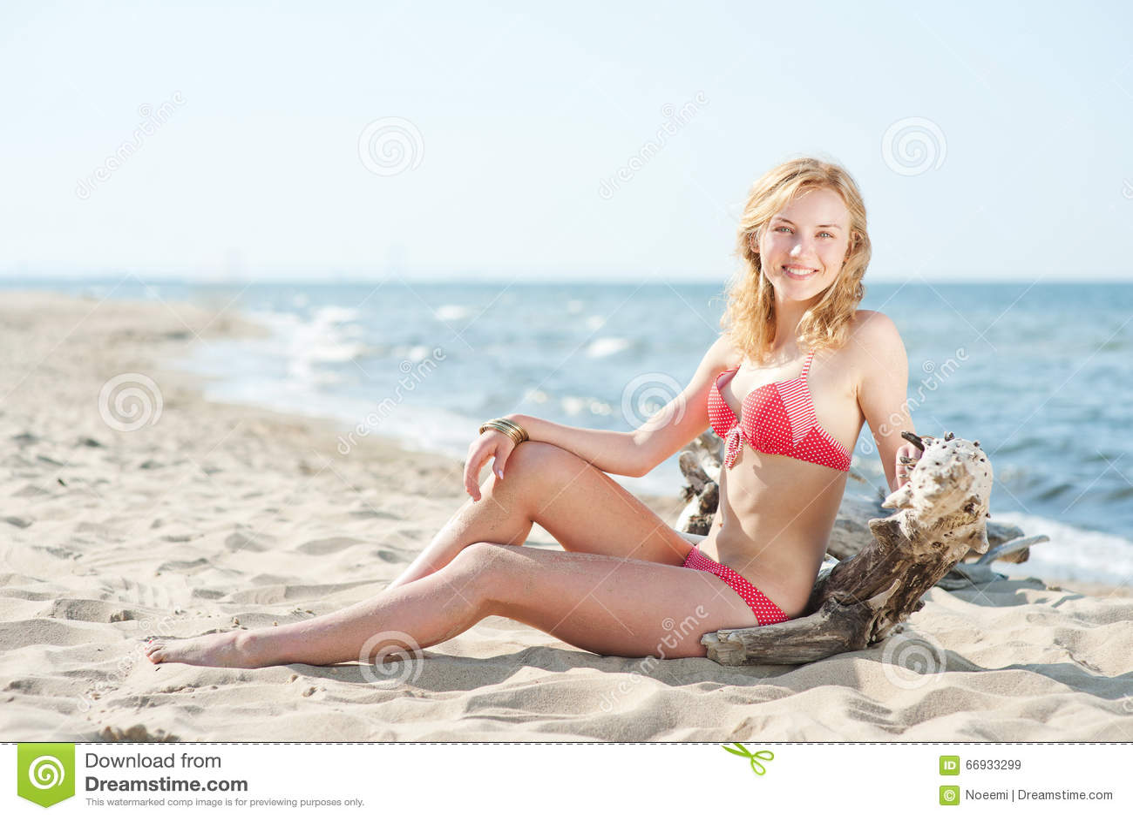 Beutiful young blond woman sunbatching on a beach