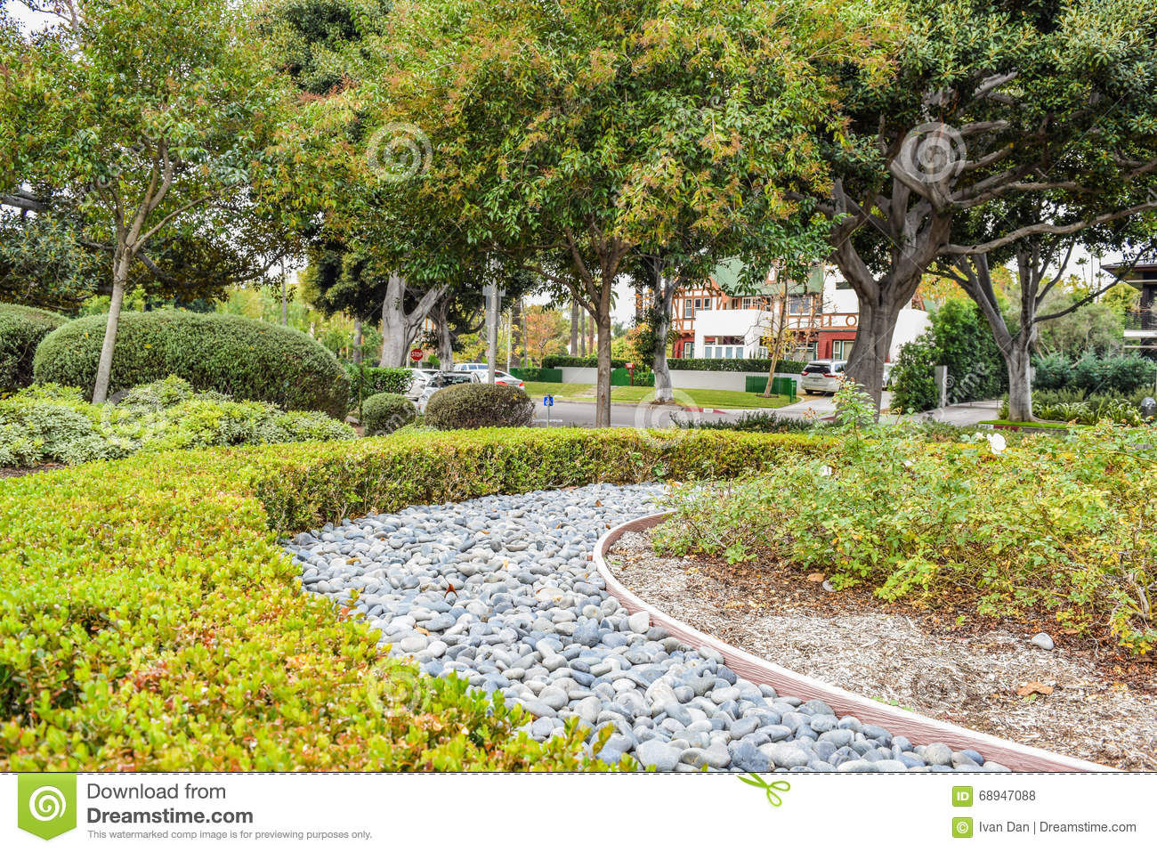 Beverly Gardens Park Nicely Trimmed Bushes Flowers And Stones In Front Of The House Front Yard Landscape Design Stock Photo Image Of Flower Beverly 68947088