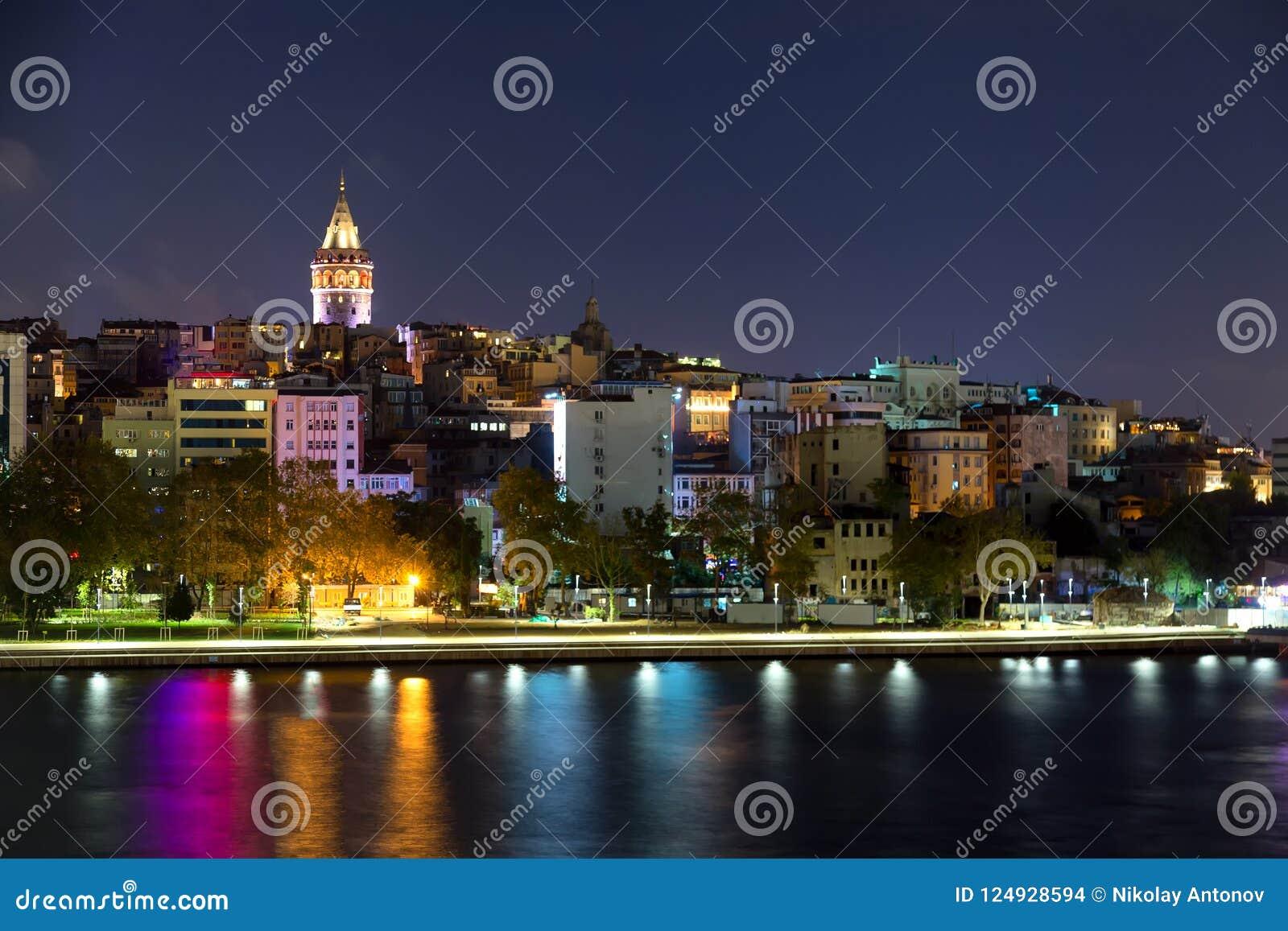 Beyoglu historic district and illuminated Galata tower medieval landmark in Istanbul at night, Turkey.