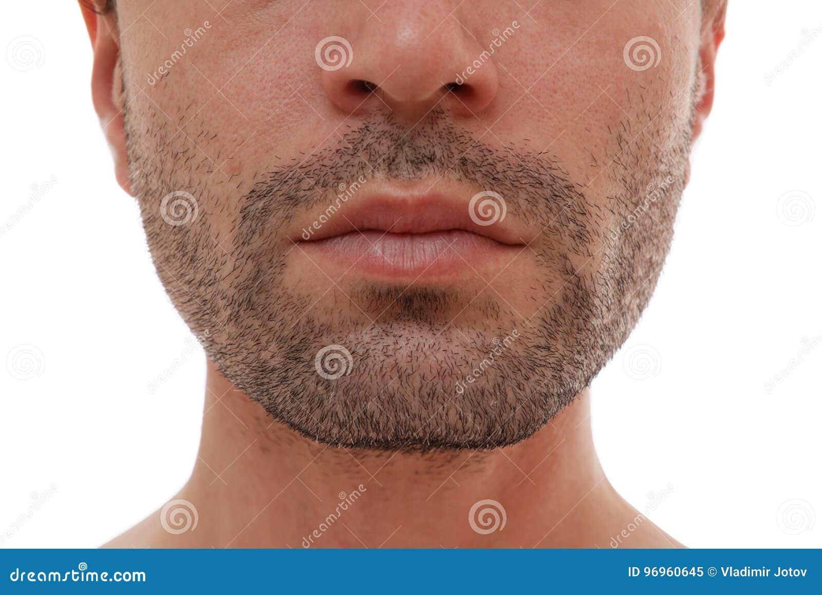 Bezaubern und halbes Gesicht des gutaussehenden Mannes