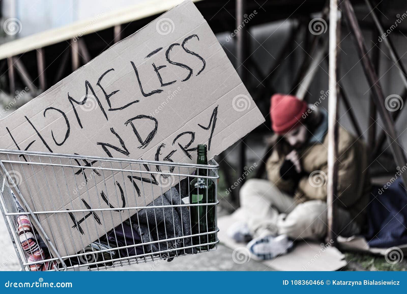 Bezdomny i głodny znak