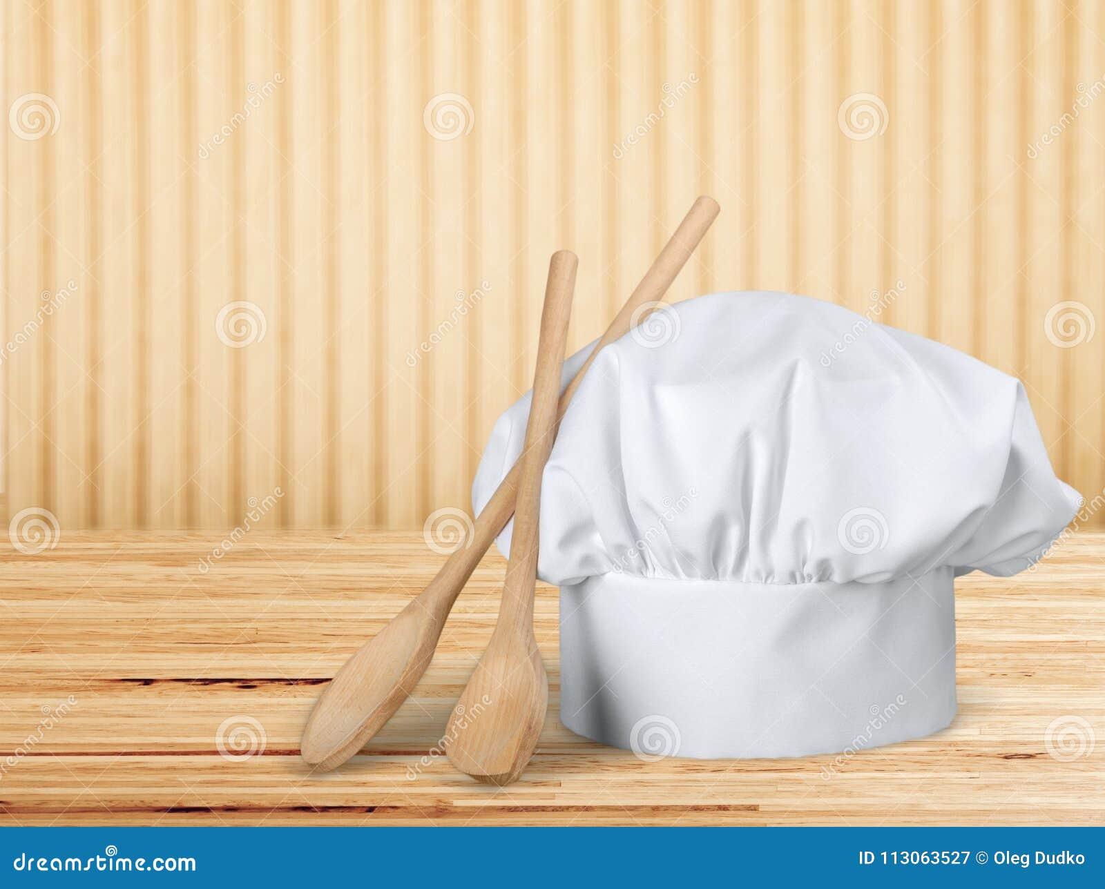 Białego szefa kuchni kapeluszowi i kuchenni naczynia