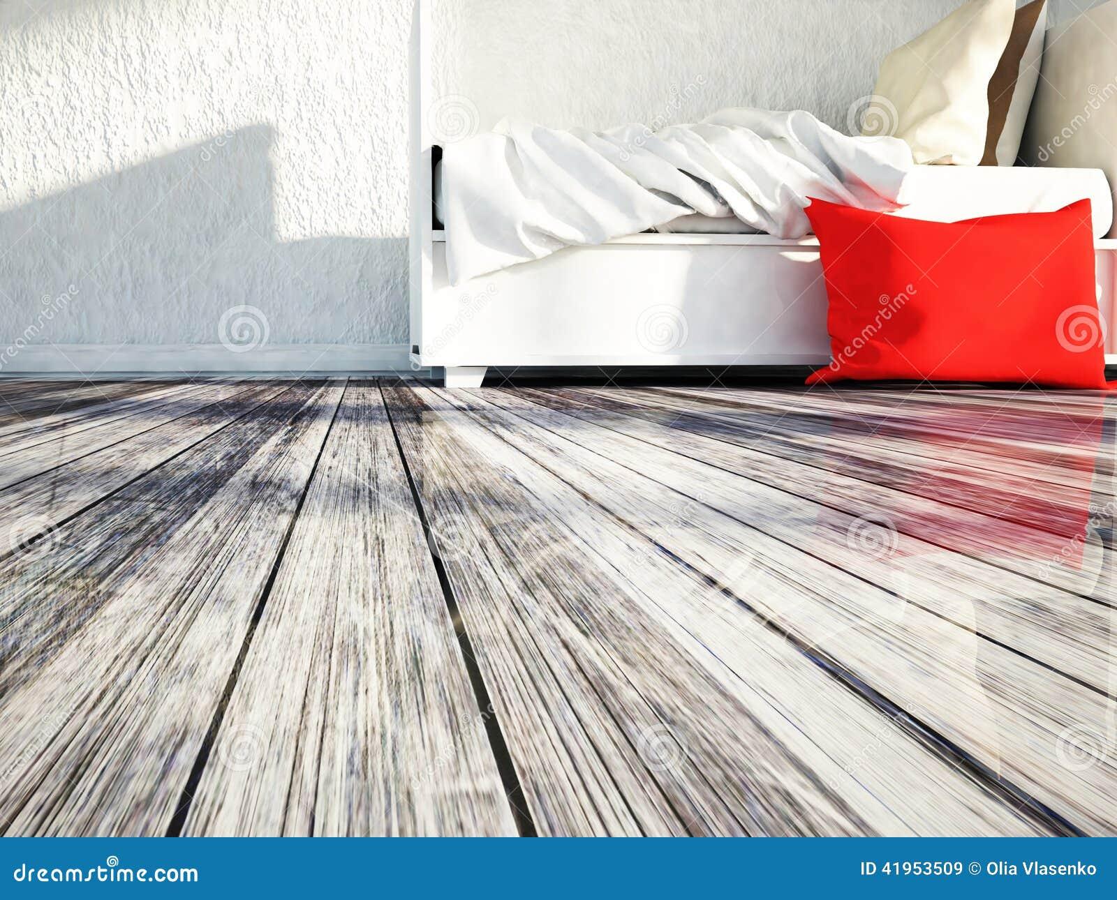 Biały łóżko na drewnianej podłoga