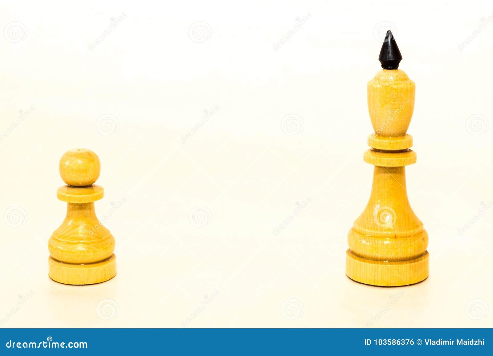 Biały szachowy pionek i królewiątko