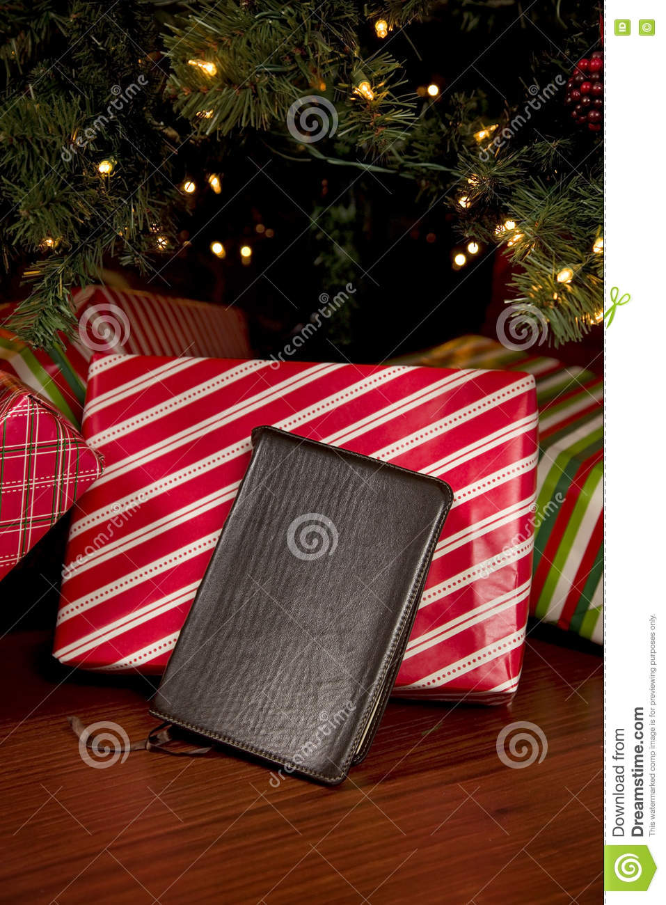 bible in front of a christmas tree