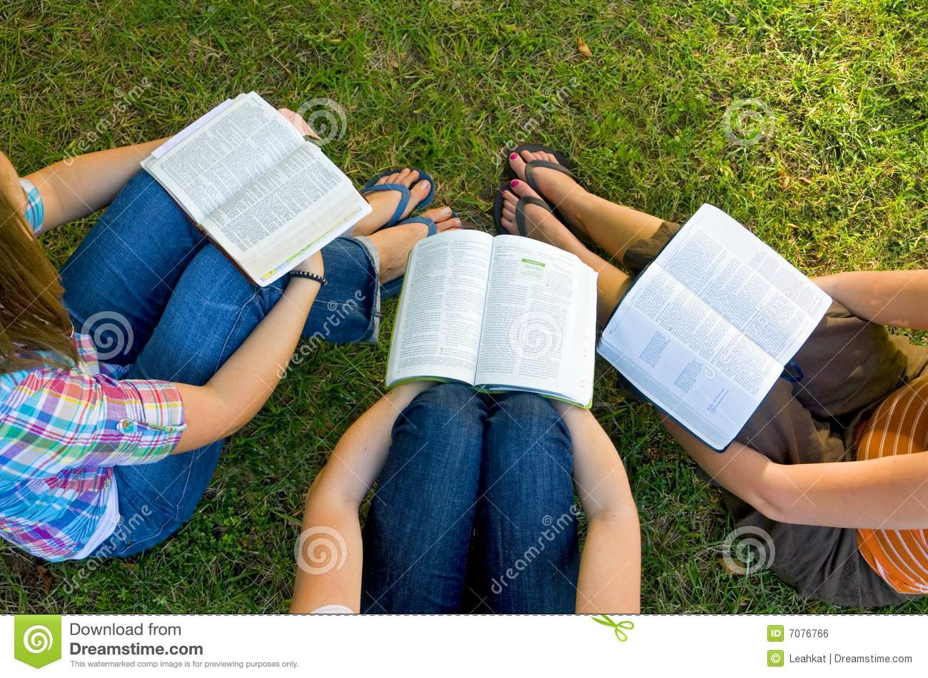 Three college students studying together on campus in the late ...