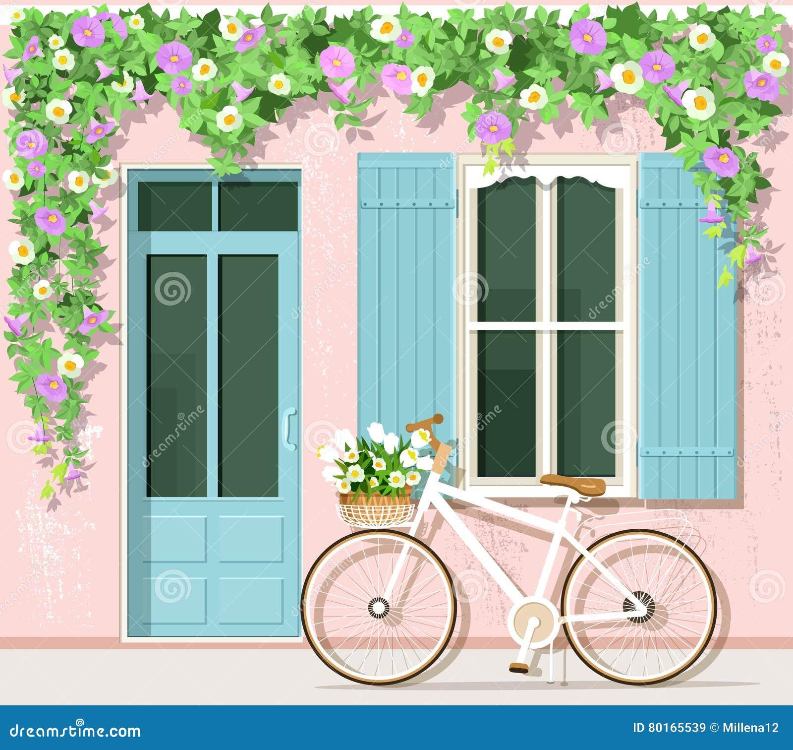 Bicicleta con las flores cerca de la casa del estilo de - La casa vintage ...
