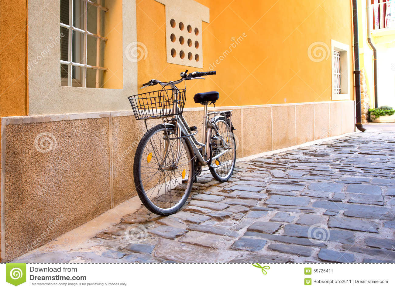 Old Rustic Bike With Flowers In Basket Leaning Against Wall Stock ...