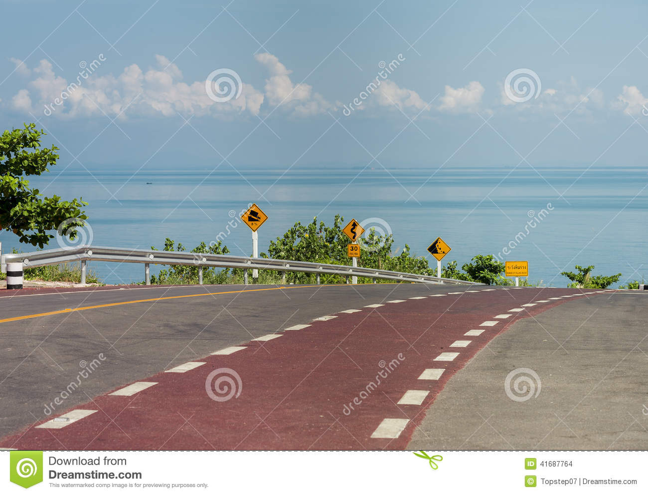Bicycle lane on curve road along the beach with Traffic sign