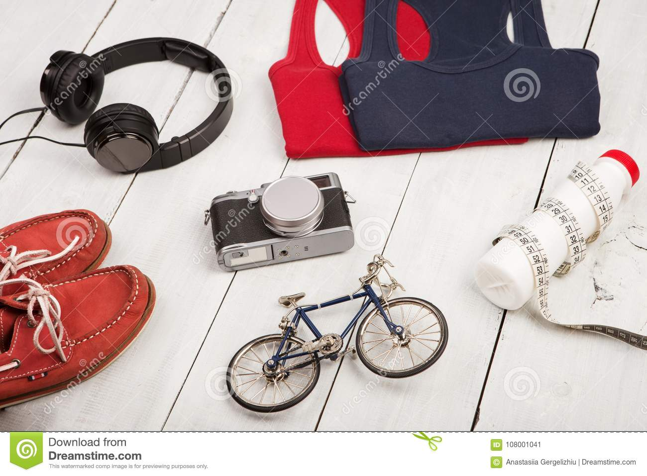 Bicycle model shoes shirts headphones camera bottle of water