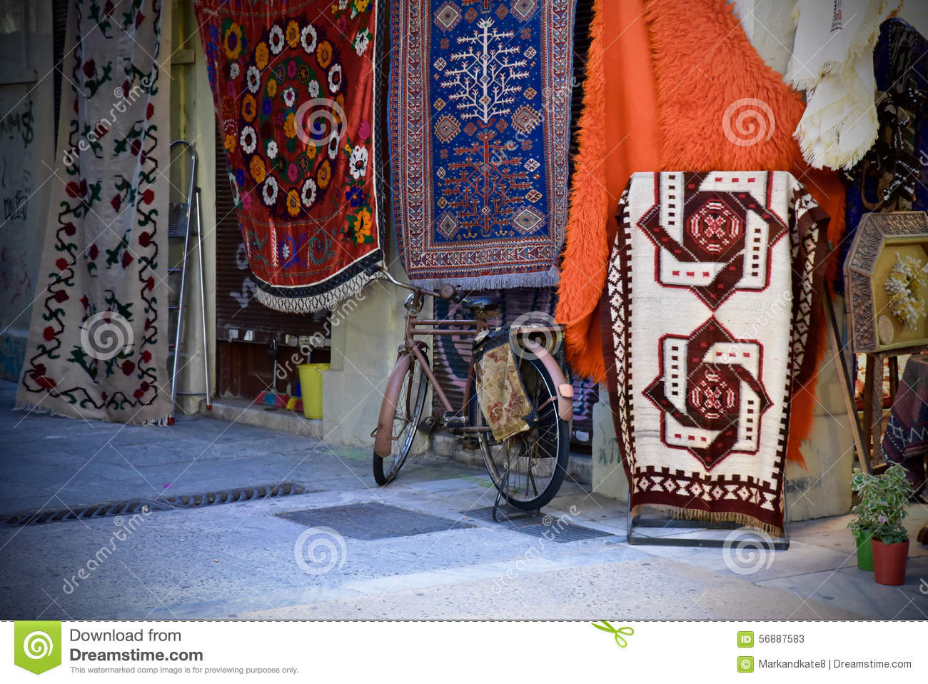 Bicycle parked in front of a rug store in Athens, Greece