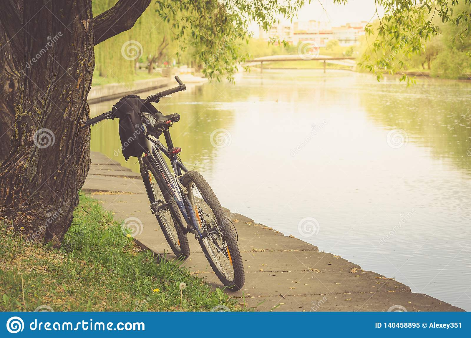 Bicycle track in park near river/walk by bicycle near the river