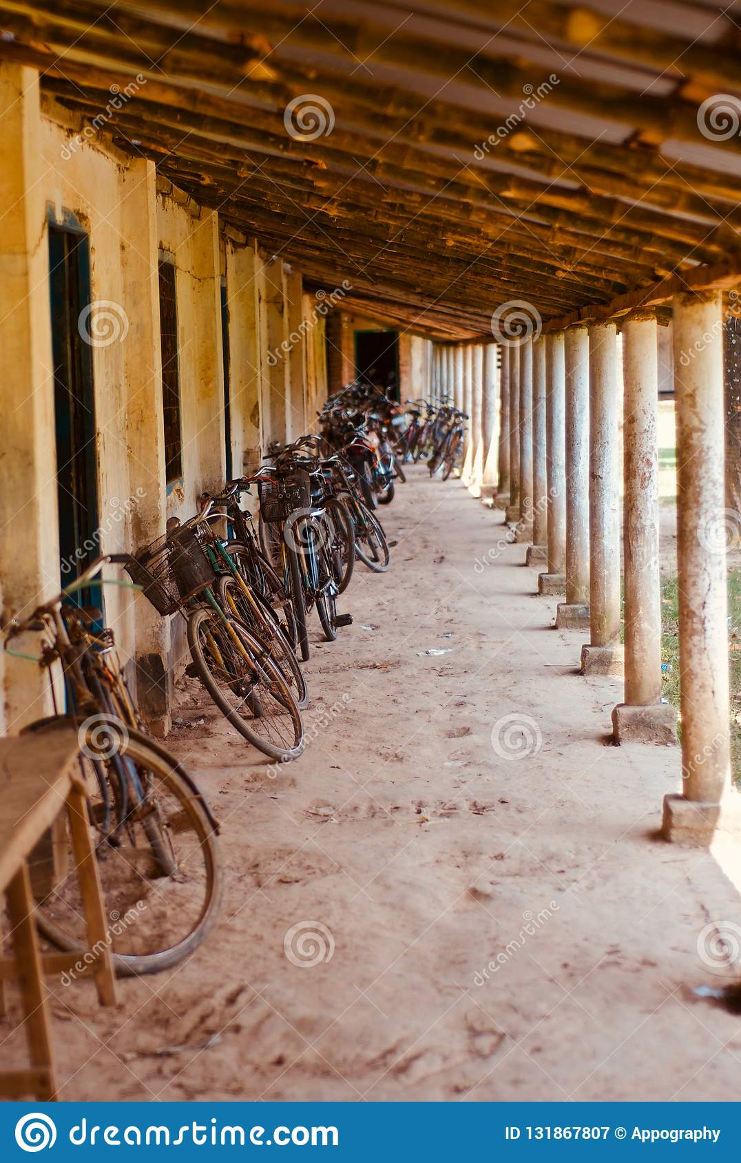 Bicycles parked around a corridor