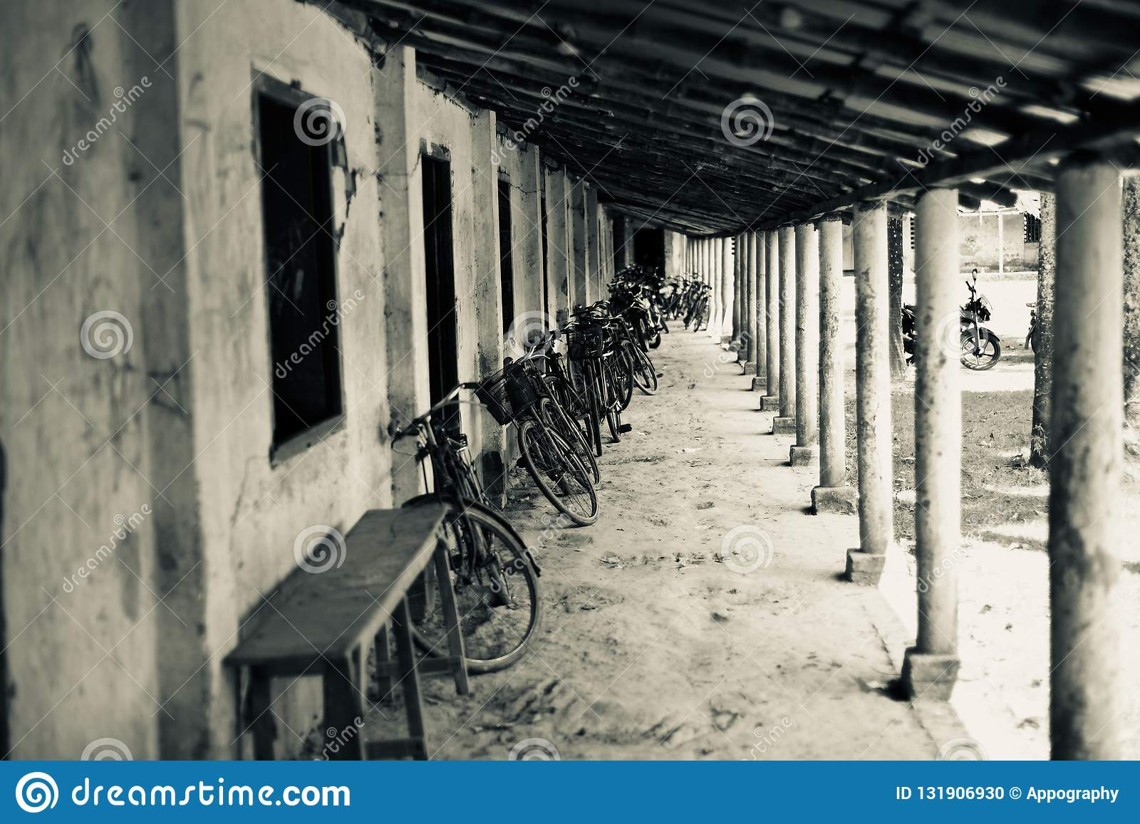 Bicycles parked in front of school rooms
