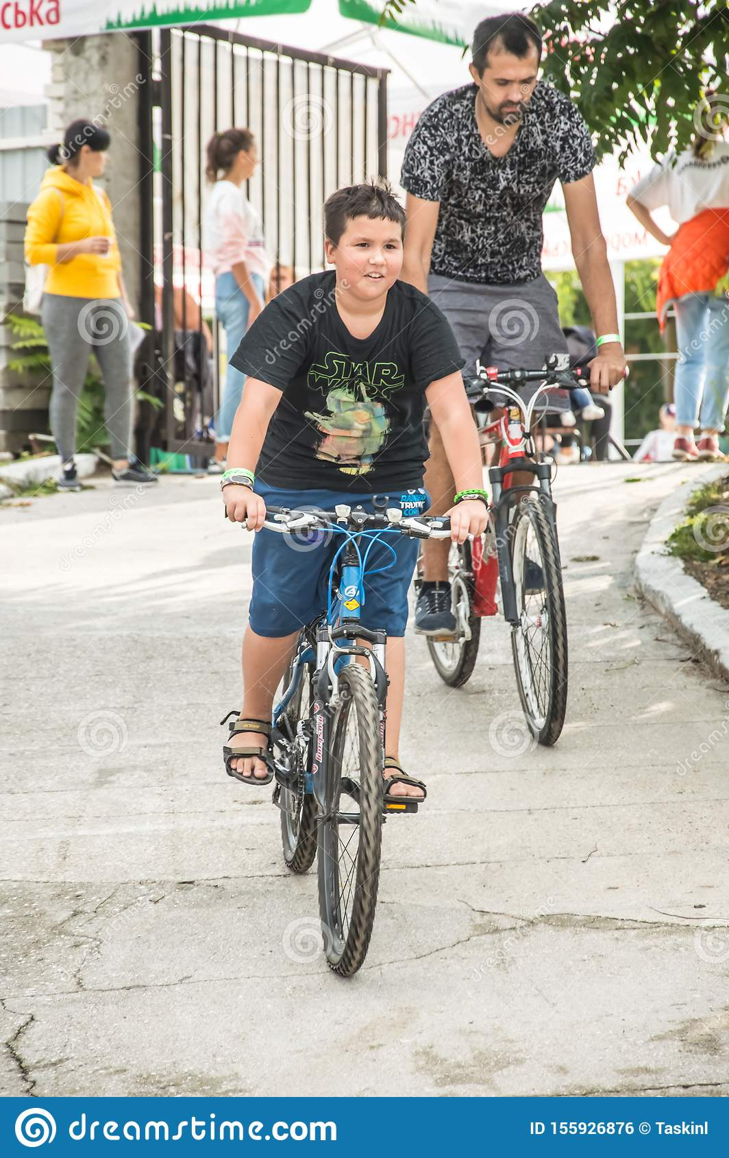 Bicyclists, adults and children, their portraits