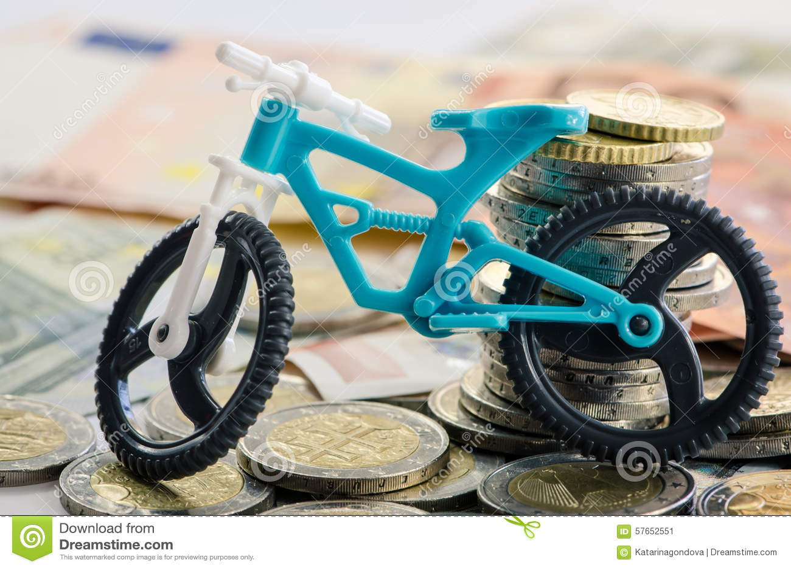 Bicykl, monety i banknoty,
