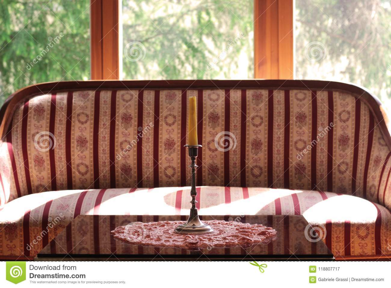 Biedermeier Sofa And A Table In Front Of A Large Window Stock Image