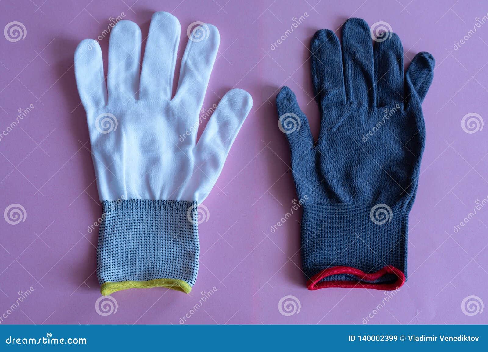 Biel i czerń pracujemy rękawiczki na różowym tle kombinezony i mundury Ręki ochrona