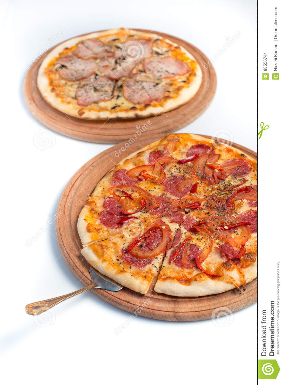 Big appetizing pizza on a wooden tablet