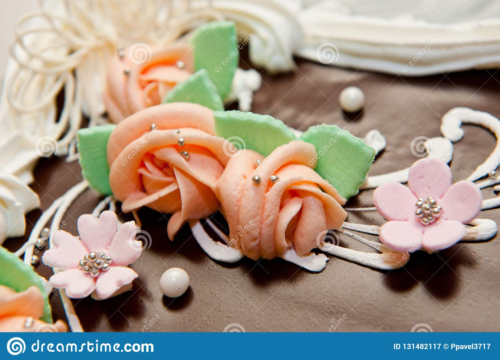 Big Beautiful Chocolate Cake Decorated With Decorative Flowers And