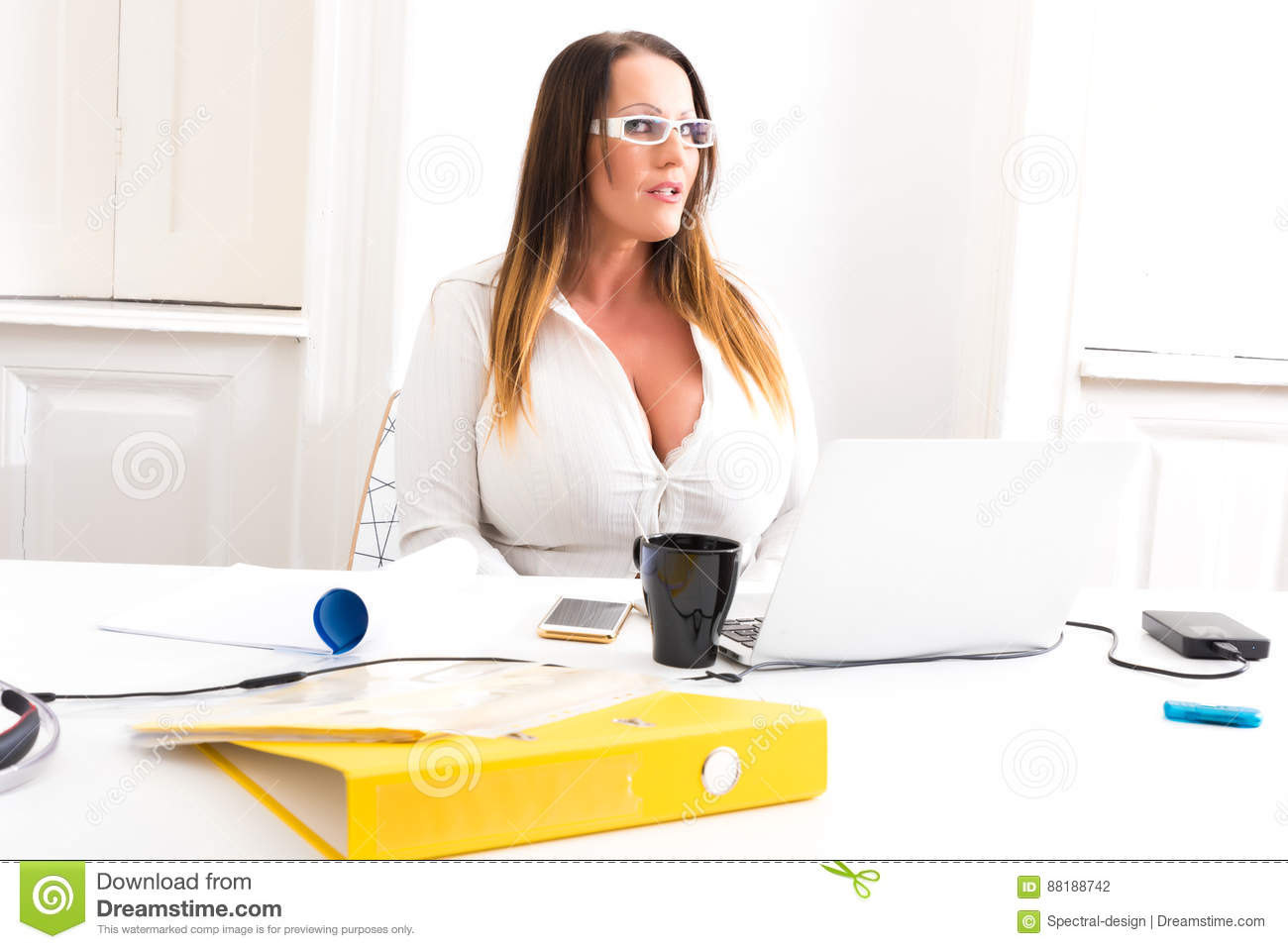 big and beautiful secretary working in a office stock photo - image