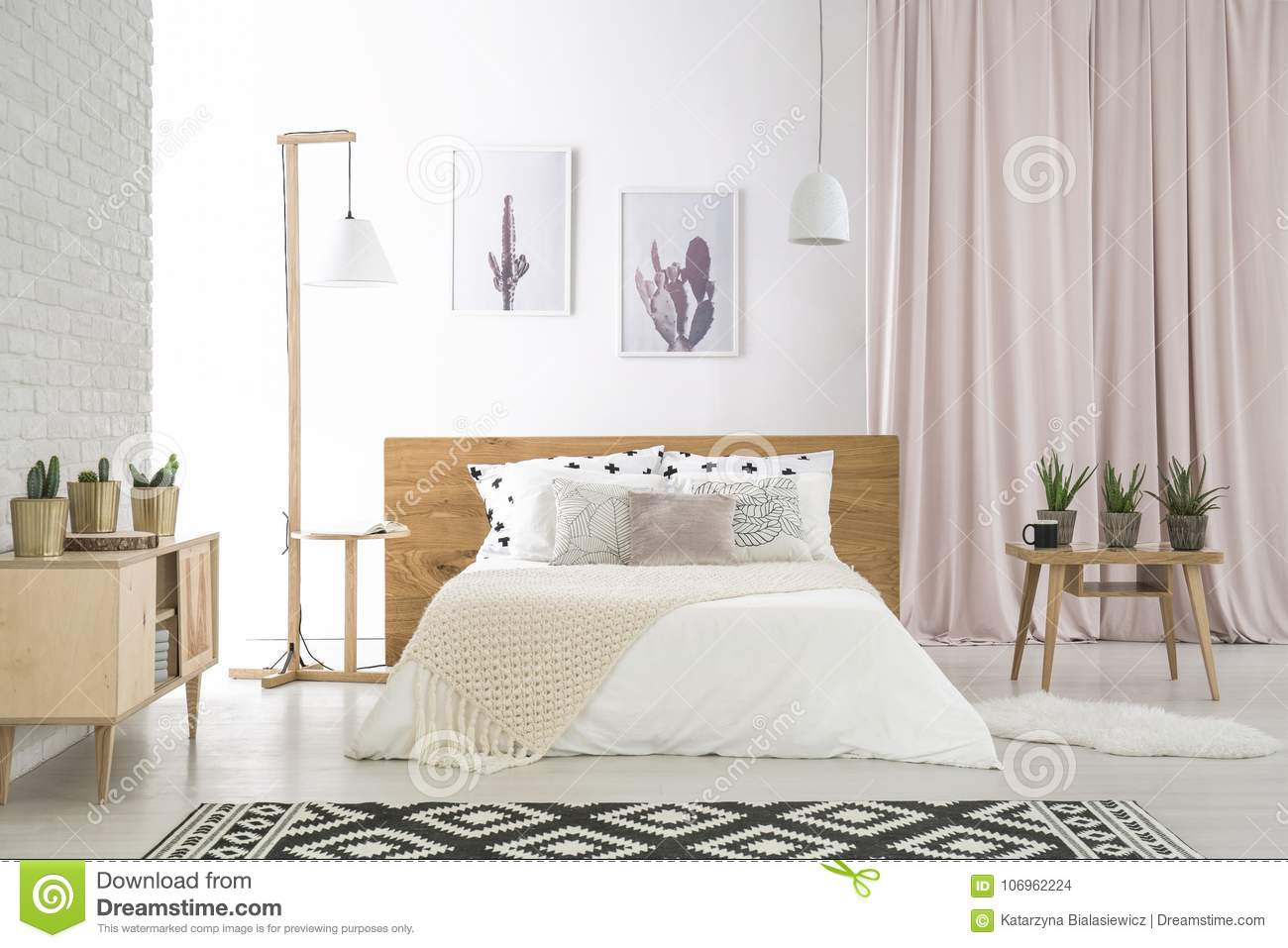 Big Bed With White Bedding In Natural, Wooden Bedroom